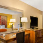 Quality Inn & Suites Laurel one bed guest room with desk