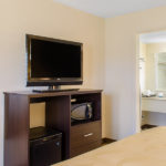 Quality Inn & Suites Laurel guest room amenities including a mini fridge, microwave, and TV