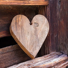 Wooden heart outside of a rustical barn