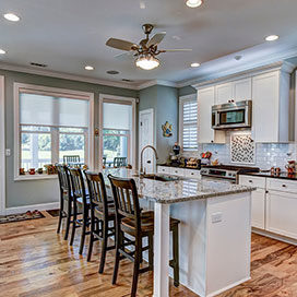 Beautiful kitchen remodel with granite countertops, stainless appliances and hardwood floors